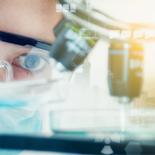 Scientist close to microscope