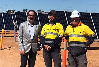 Minister Pakula (left) visited the Beon Energy Solutions solar farm. He is pictured with Kienan Jones and Ishaq Ali Rezaei from Beon Energy.